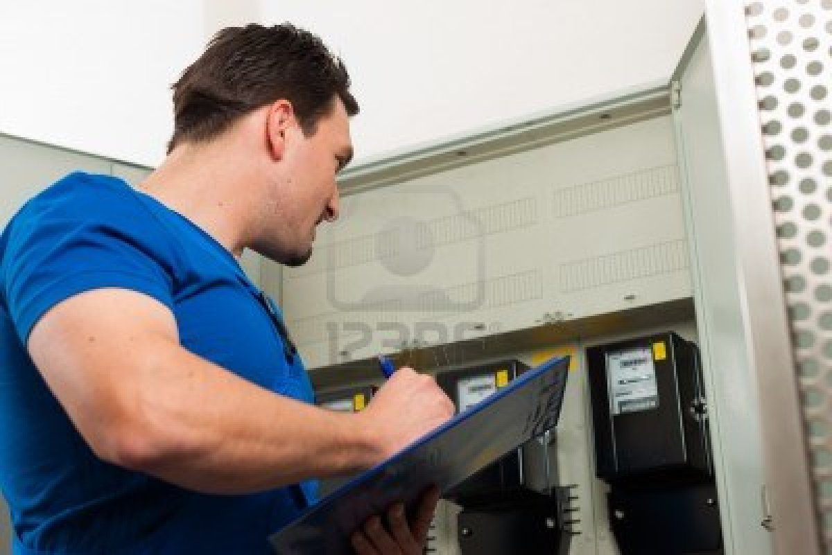 10269896-technician-reading-the-electricity-meter-to-check-consumption[1]
