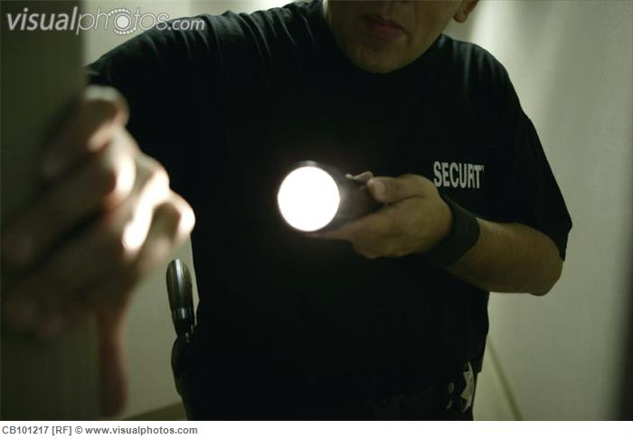 security_guard_holding_flashlight_CB101217[1]
